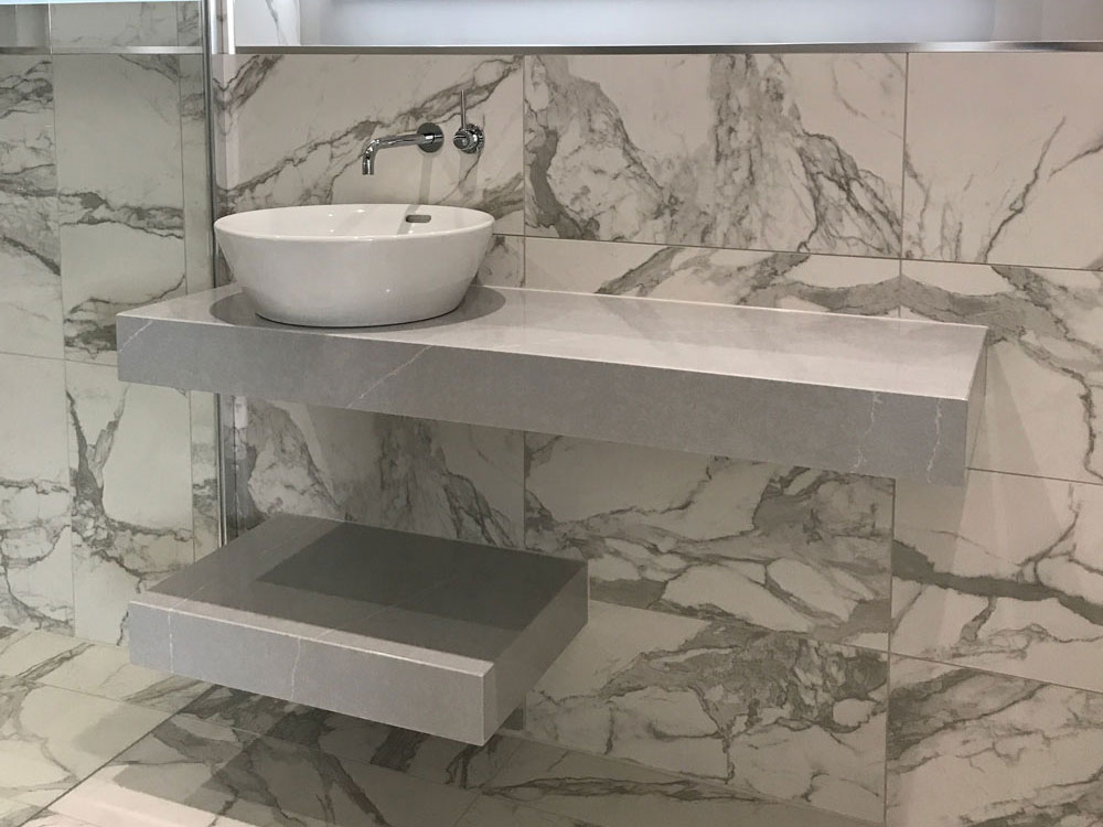 Bianca Eclipsia Quartzite (cabinetry by Kandu Interiors)
