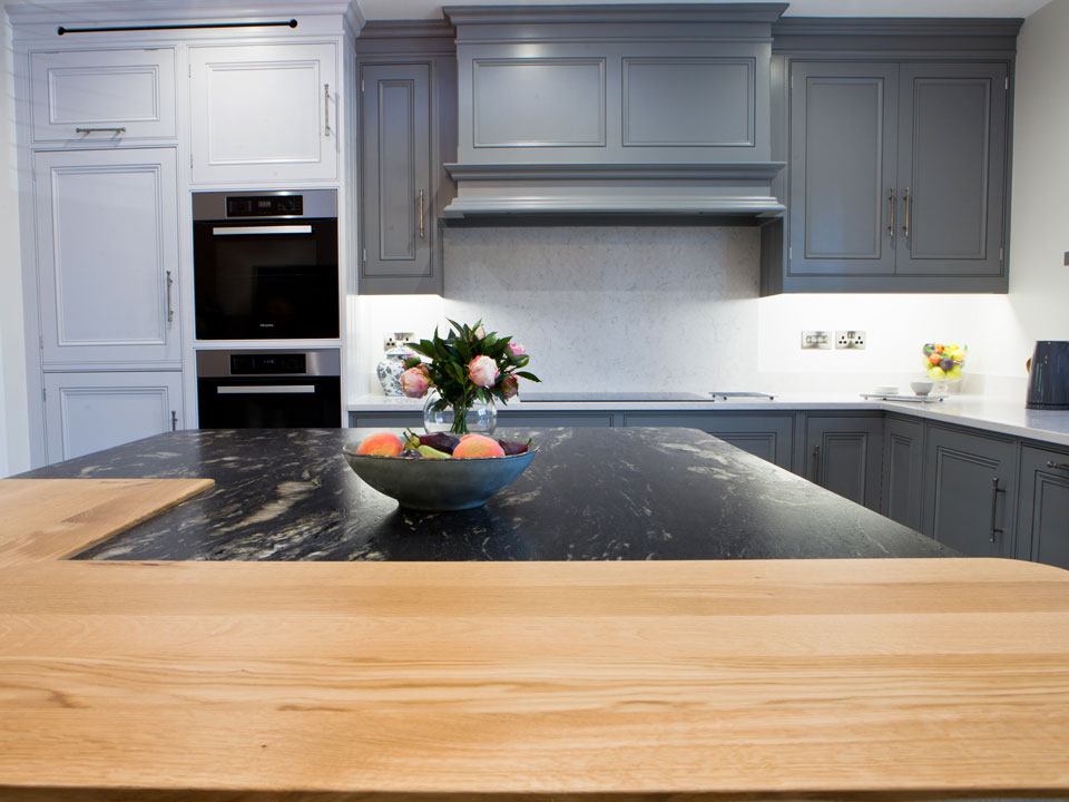 Silestone Lagoon & Cosmic Black Leather Granite (cabinetry by Grand Union Designs)