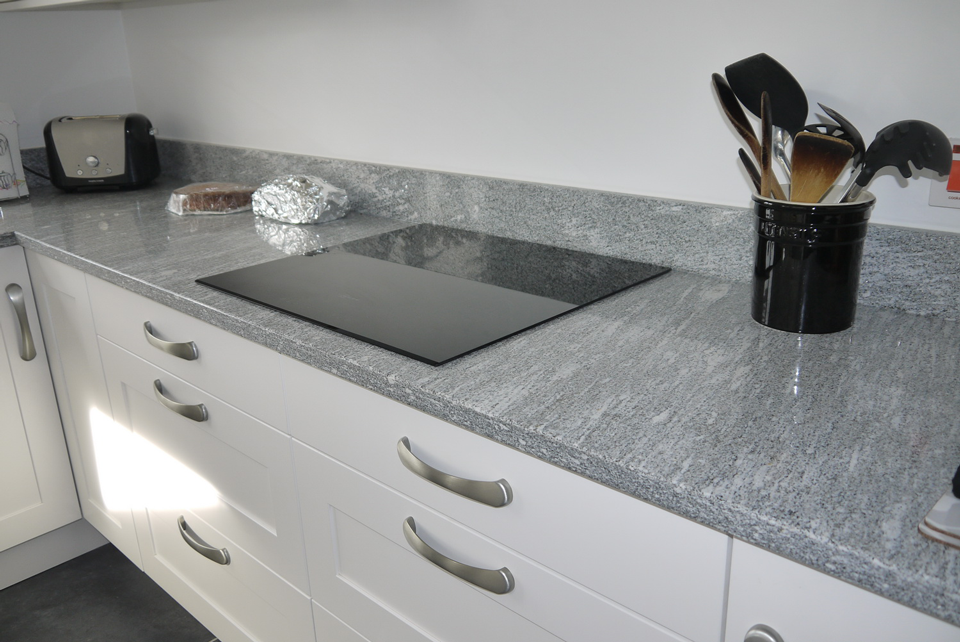 White Storm Granite (cabinetry by Cloisters Design)
